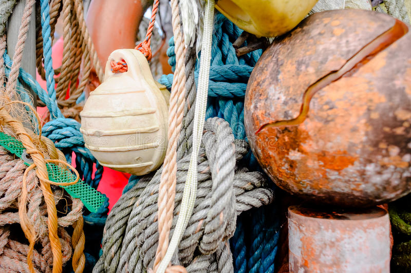 Nautical background. Closeup of old colorful mooring ropes , Old. Closeup of old colorful mooring ropes , Old buoys and fishing gear at the island Texel stock photo