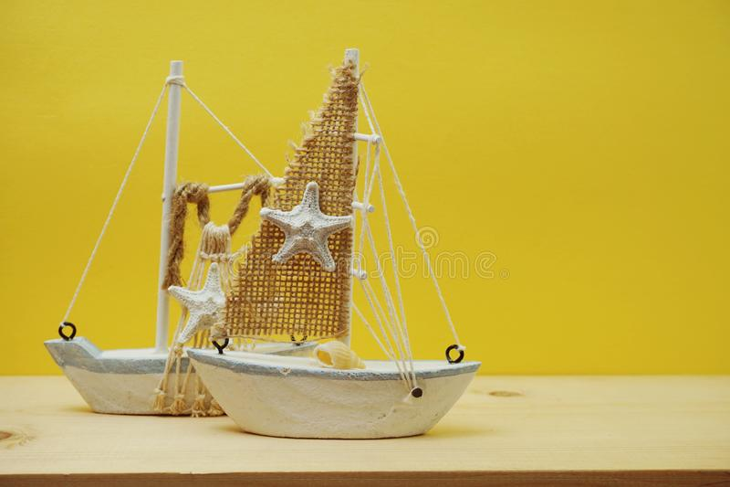 Nautical background with Sailboat Model on yellow background stock image