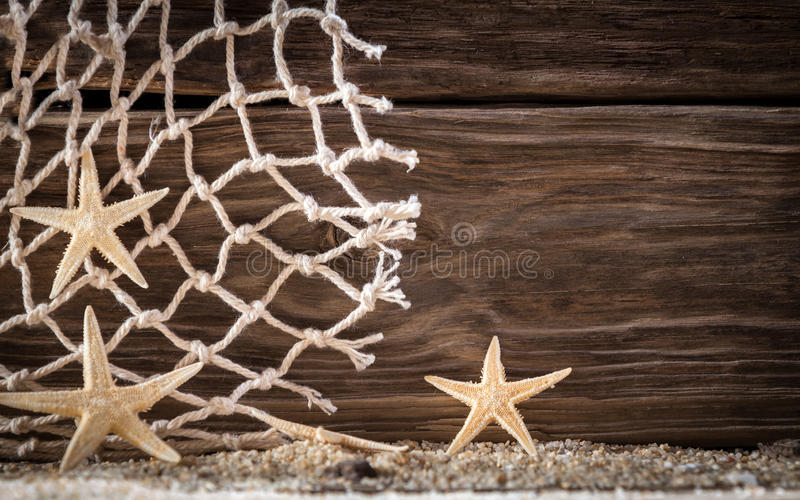 Nautical background with starfish and fishing net stock image