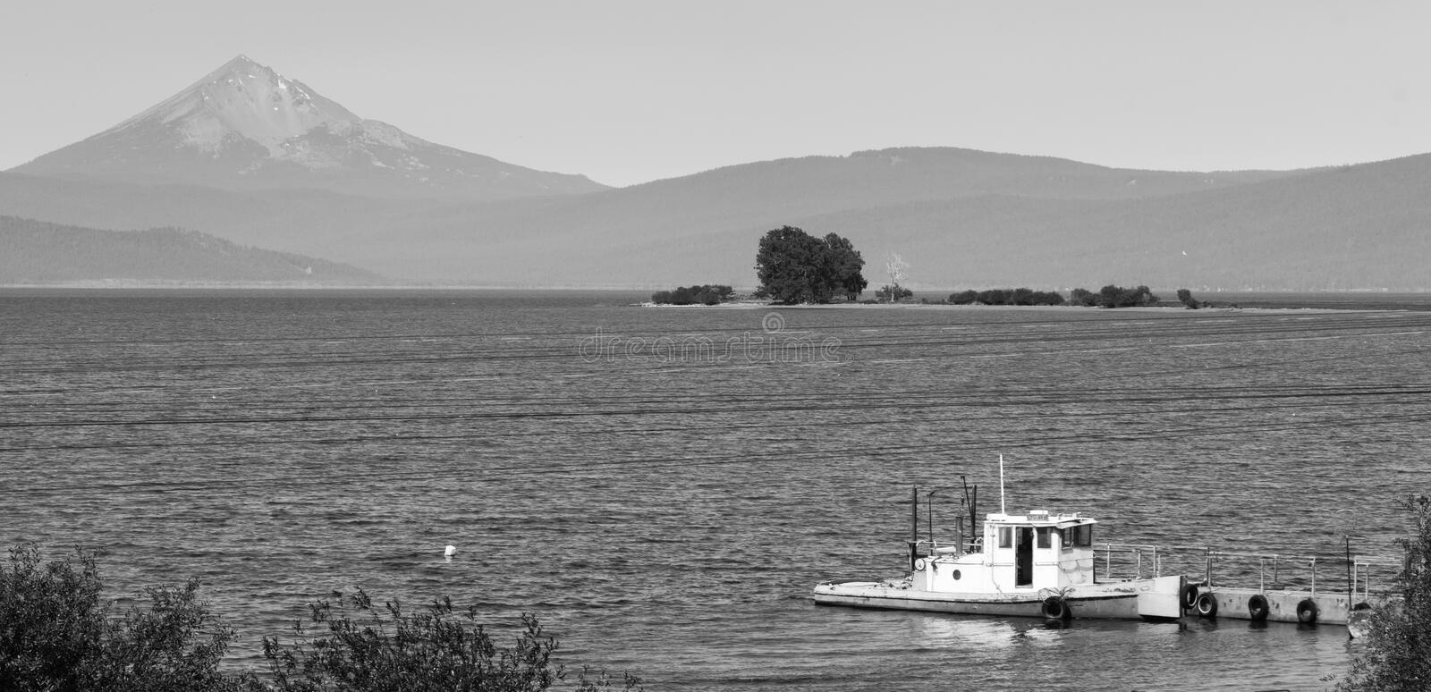 Nautical Boat Klamath Lake Mt McGloughlin. An ol boat on Klamath Lake in southern Oregon stock images