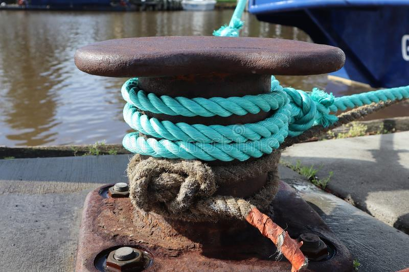 Nautical Rope Tied on Old Metal. Nautical boating rope tied on to old metal anchor stock photos