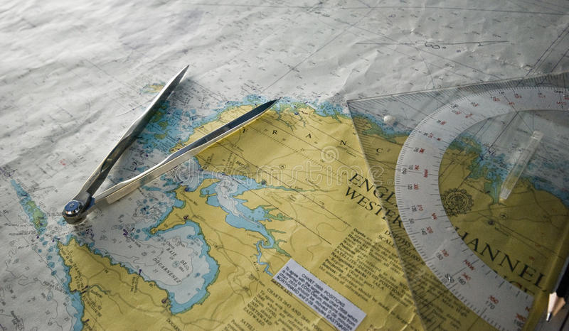 Nautical Chart close up. Nautical Chart close up together with divider and triangular ruler to plot position on the maritime map royalty free stock images