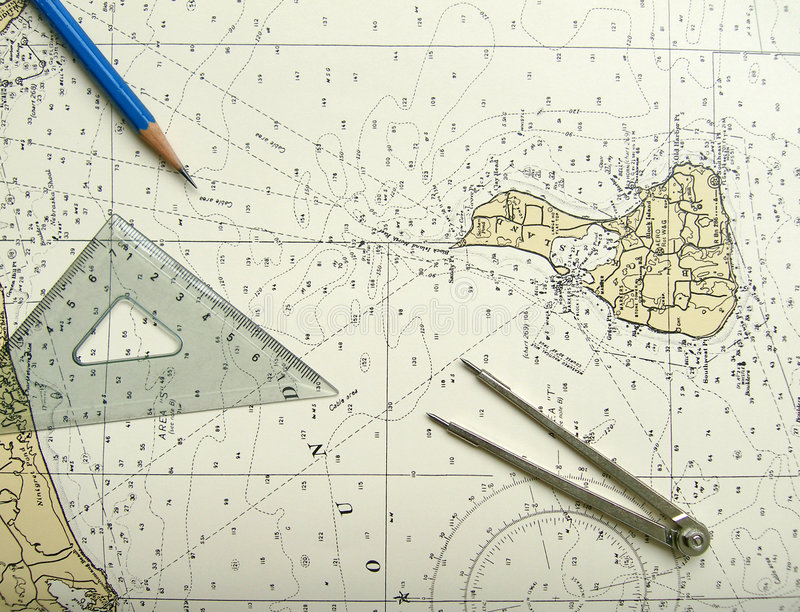 Nautical chart and divider. A blue wood pencil pointing to a place on an old nautical chart, used for sailing and navigation on seas and oceans. Topography map stock photos