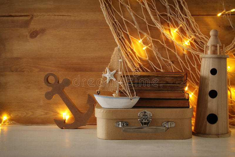 Nautical concept with sea life style objects on wooden table. Nautical concept with sea life style objects on wooden table stock photography