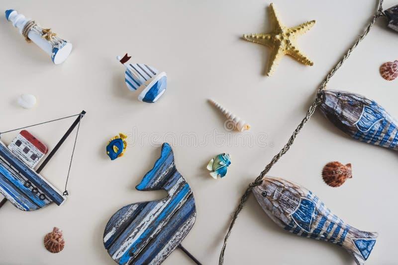 Nautical life style items: sea shells, fish, rope, lifebuoy. Marine concept. royalty free stock image