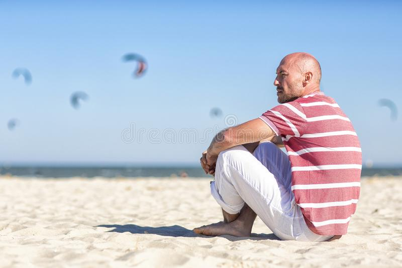 Nautical theme.Sea tour. North sea. A young man resting on the beach.Germany. royalty free stock photography