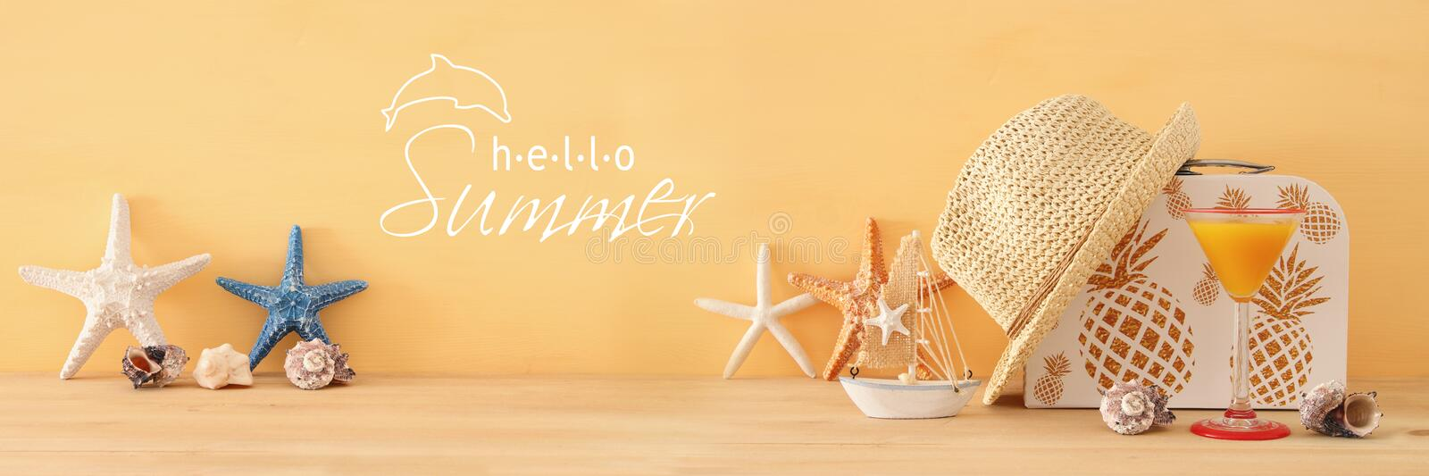 Nautical, vacation and travel banner with sea life style objects over wooden table. Nautical, vacation and travel banner with sea life style objects over wooden royalty free stock image
