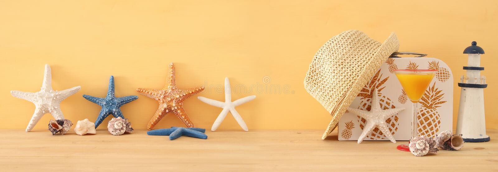 Nautical, vacation and travel banner with sea life style objects over wooden table. Nautical, vacation and travel banner with sea life style objects over wooden royalty free stock photo