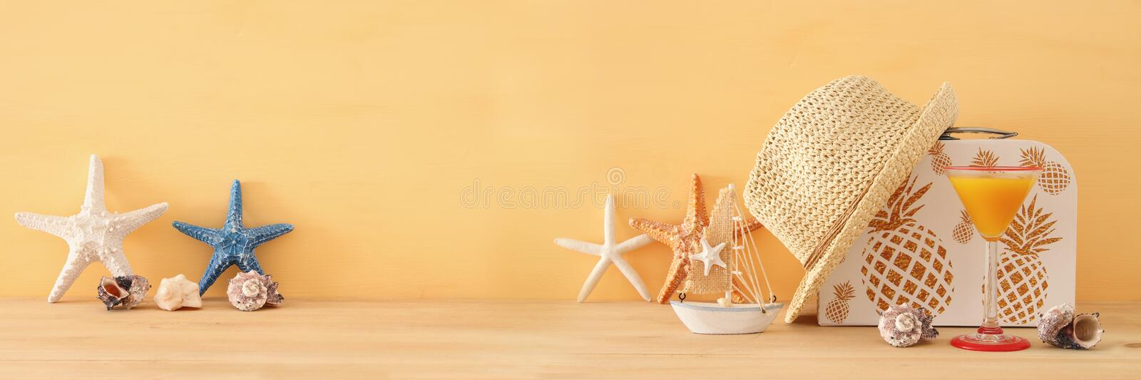 Nautical, vacation and travel banner with sea life style objects over wooden table. Nautical, vacation and travel banner with sea life style objects over wooden stock photography