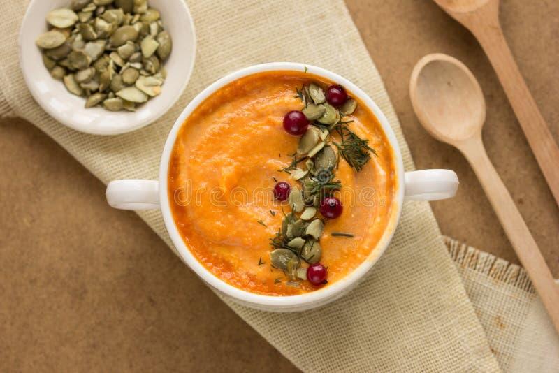Pumpkin porridge pumpkin soup with seeds, milk and raw pumpkin royalty free stock image