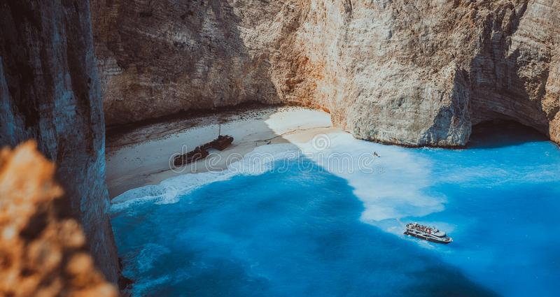 Navagio beach panoramic shot in moody vintage waved bay water and abandoned shipwreck on shore. Zakynthos Island, Greece royalty free stock photos