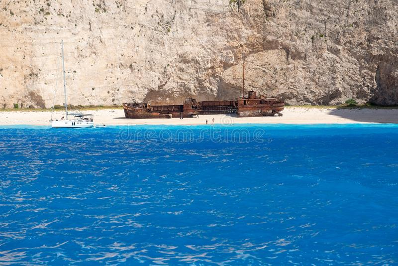 Navagio Beach in summer time with blue water of Greece , Zakintos. In Cyclades island royalty free stock image