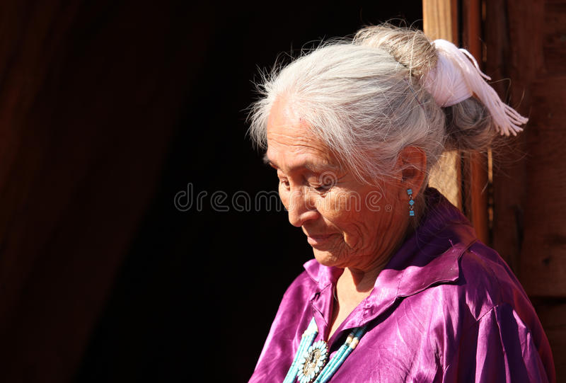 A Navajo Woman Looking Down Outdoors in Bright Sun royalty free stock photo