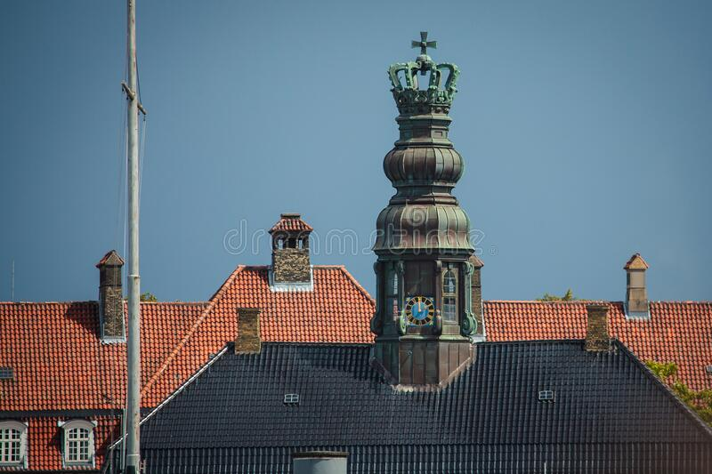 Naval brig, Copenhagen. The roof with an ornate clocktower of the seventeenth-century building, naval brig, Copenhagen stock images