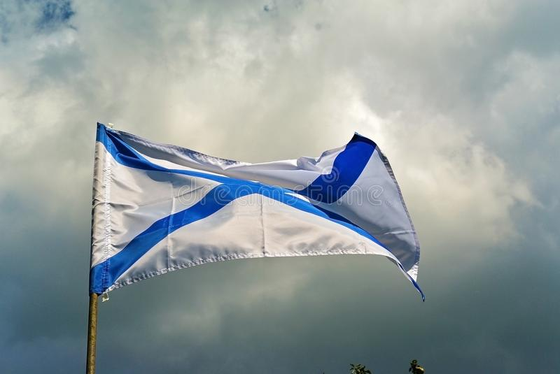 Naval flag of the Russian Navy St. Andrew on a blue sky royalty free stock photography