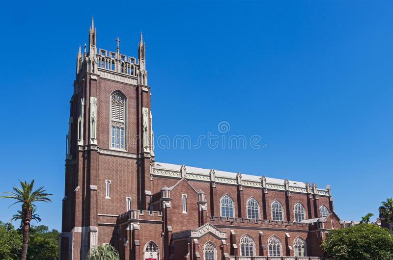 Landmark Church Bell Tower and Nave in New Orleans. Nave and bell tower exterior of landmark church in new orleans louisiana royalty free stock image