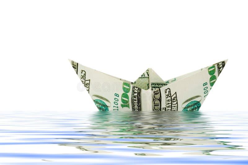 Nave hecha del dinero en agua imagen de archivo libre de regalías