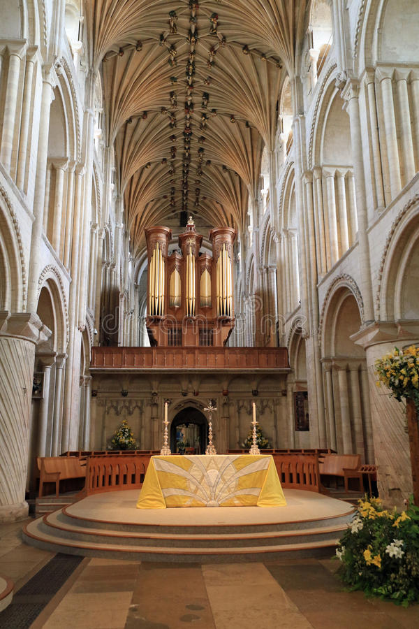 The nave - Norwich Cathedral. He cathedral was begun in 1096 and constructed out of flint and mortar and faced with a cream-coloured Caen limestone. A Saxon royalty free stock photography