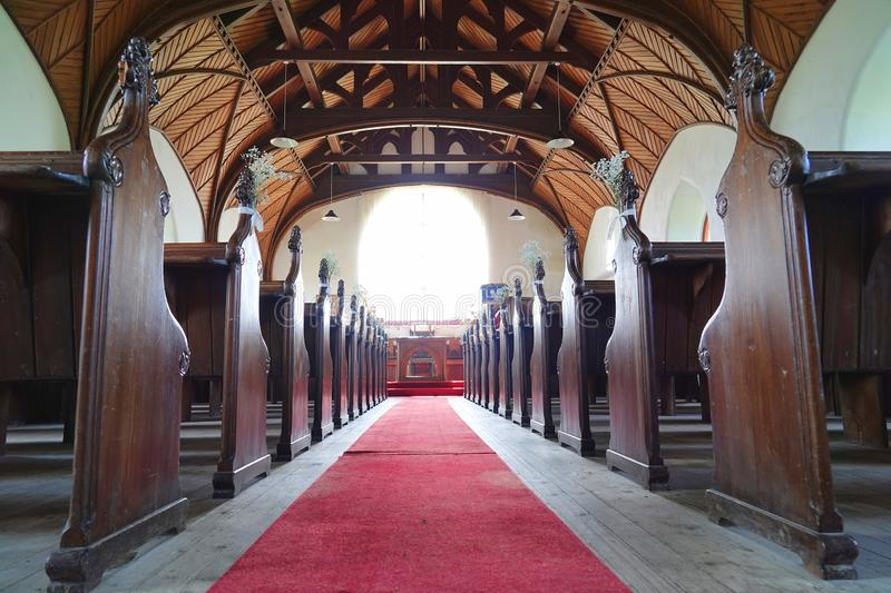 Nave and pews in Scottish church. The nave and pews inside The Church on the Hill in the village of Arinagour on the island of Coll in Scotland royalty free stock photo