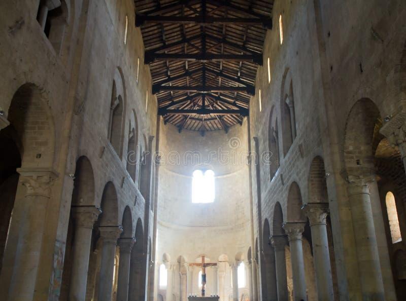 Nave of St. Antimo Abbey. Abbazia di Sant'Antimo, Montalcino, Tuscany, Italy stock photography