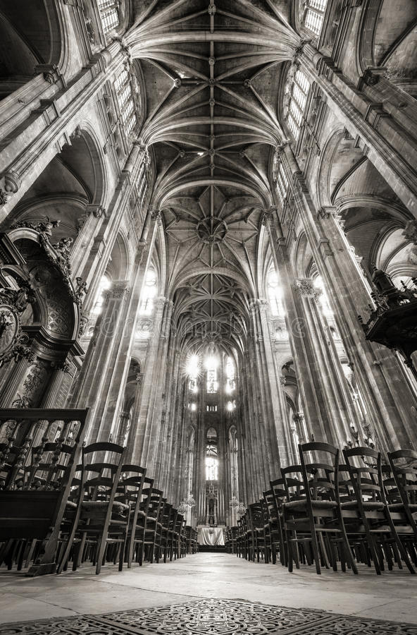 Nave with Vaulted Arches, Church of Saint Eustache, Paris, France. Black & White interior photo of the nave, Church of Saint Eustache, Paris, France. Rows of stock images