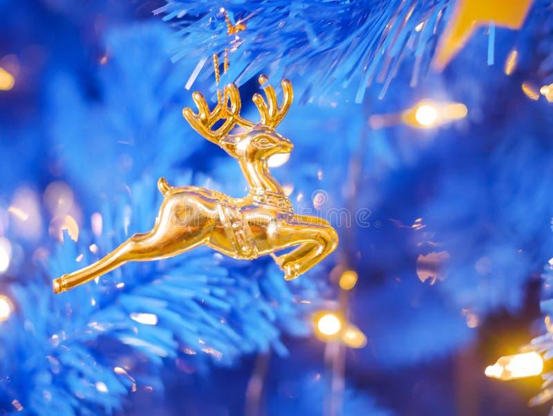 Navidad de los renos dorados imagenes de archivo