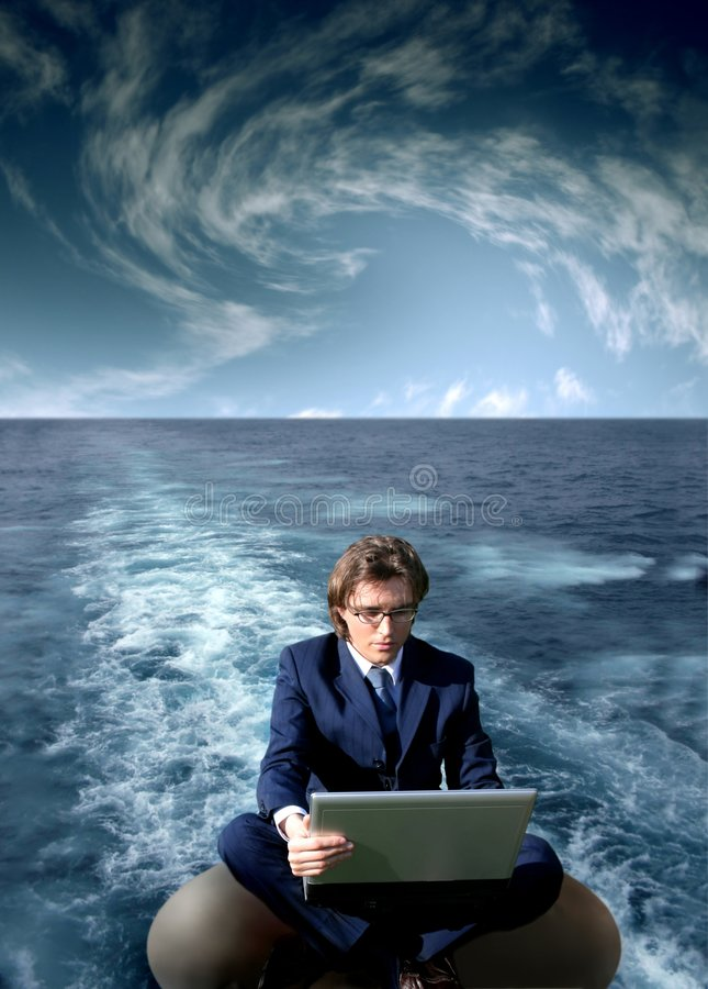 Navigate. A man with a laptop on the water