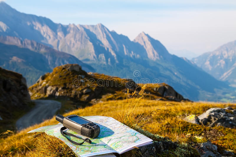 Navigate with GPS in the mountain stock image