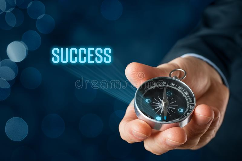 Navigate and motivate to success. Concept. Businessman with compass aspire to success royalty free stock images