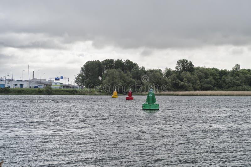 Navigation buoys. Three navigation buoys in the old maas river at rotterdam royalty free stock photo