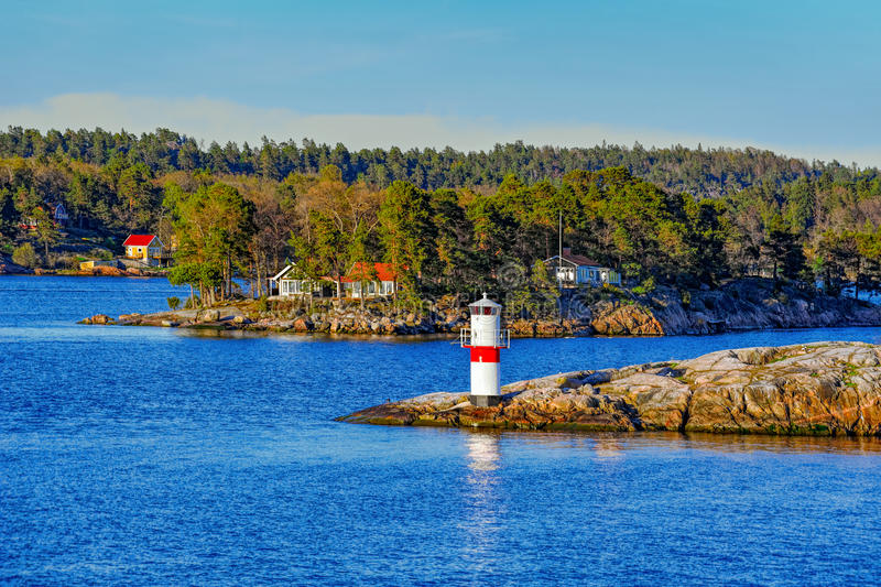 Navigation marks in the Stockholm archipelago. Marine signs and lighthouse in the Stockholm archipelago rocky island to help you navigate in shallow water stock images