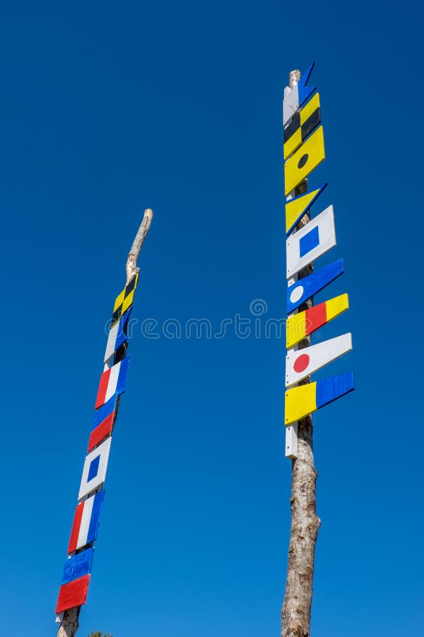 Navigation signal flags on two poles stock photo