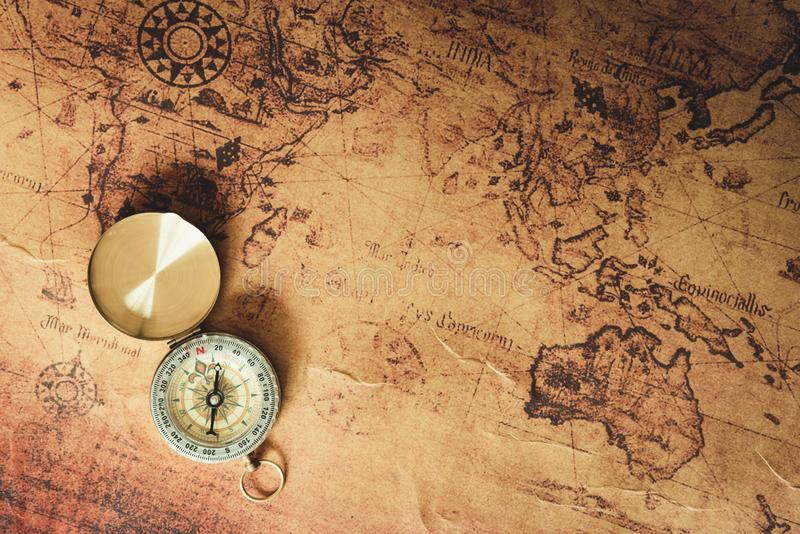 Navigator explore journey with compass and world map., Travel destination and planning vacation trip., Vintage concept royalty free stock photography