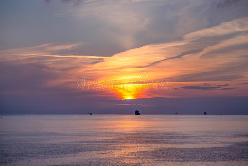 Navios no mar aberto no por do sol fotografia de stock royalty free