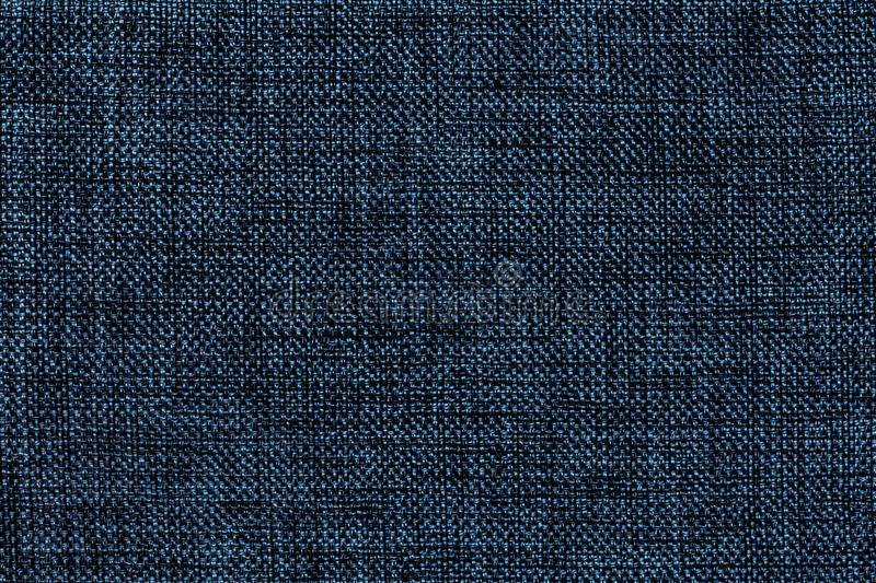 Navy blue background of dense woven bagging fabric, closeup. Structure of the textile macro. stock images