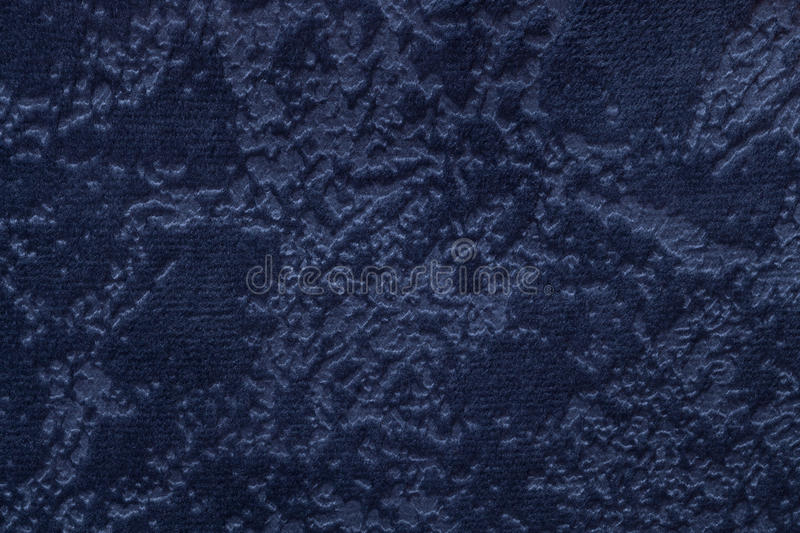 Navy blue background from a soft upholstery textile material, closeup. stock image