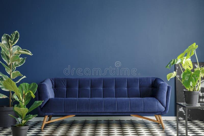Dark blue living room interior stock image