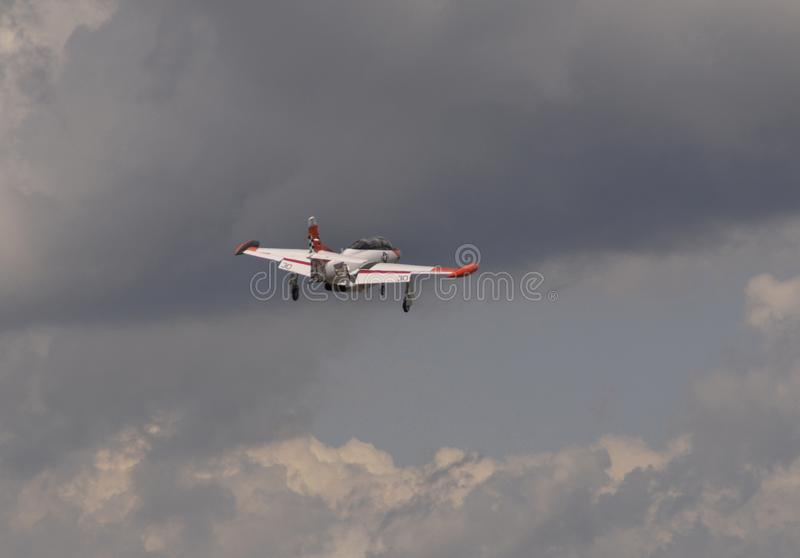 The Navy jet flying in the skies over Michigan. A Navy Jet in Flight over Belleville, Michigan stock photo