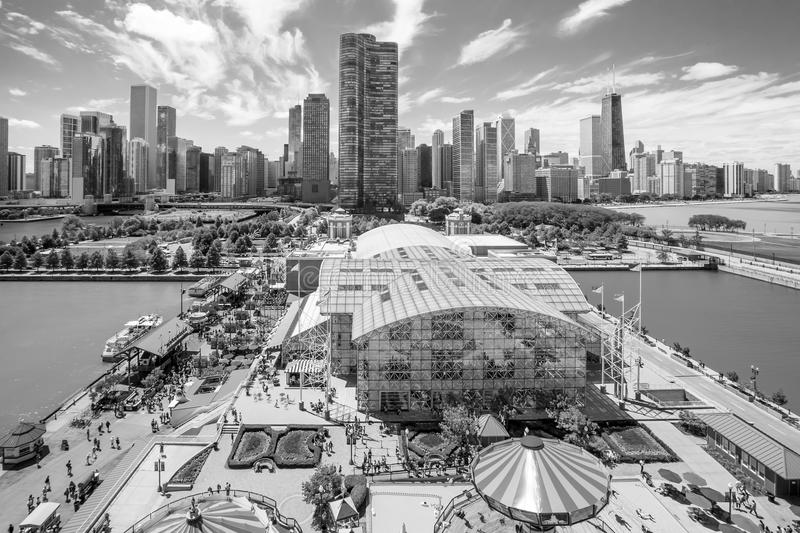 Navy Pier in Chicago. CHICAGO, IL - OCT 1: Navy Pier and skyline on October 1, 2013 in Chicago, Illinois. It was built in 1916 as 3300 foot pier for tour and royalty free stock images