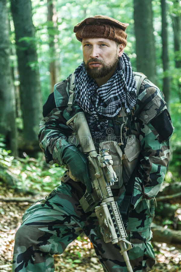 Navy SEAL Taliban hunter. Member of Navy SEAL Team also known as Taliban hunter with weapons stock photo
