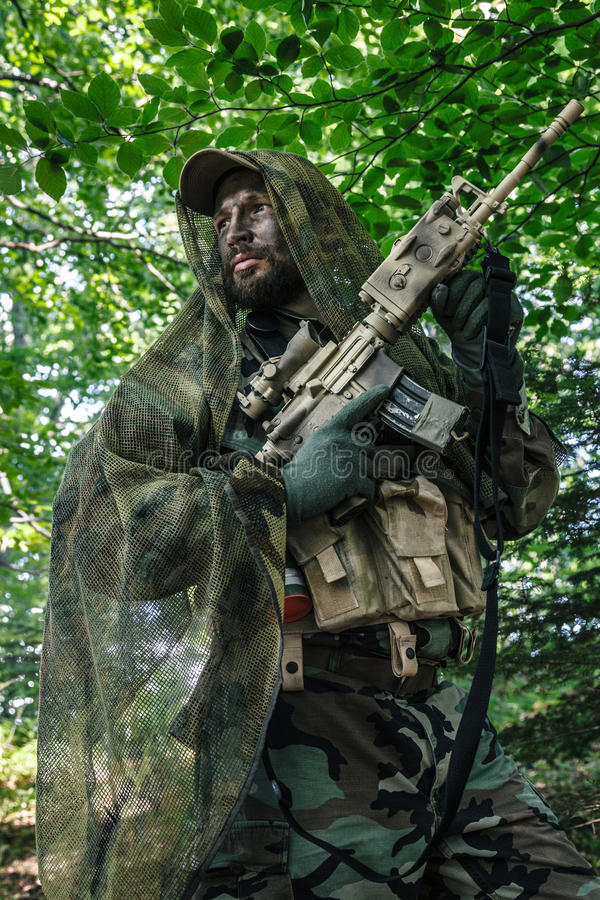 Navy SEAL Taliban hunter. Member of Navy SEAL Team also known as Taliban hunter with weapons royalty free stock photo