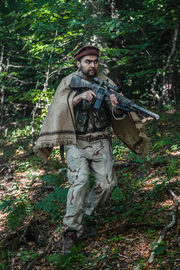 Navy SEAL Taliban hunter. Member of Navy SEAL Team also known as Taliban hunter with weapons royalty free stock images