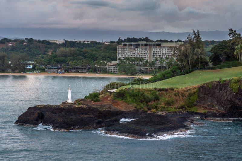 Kukii Point Lighthouse or beacon in Nawiliwili, Kauai, Hawaii, USA. Nawiliwili, Kauai, Hawaii, USA. - January 11, 2012: Early morning light on Kukii Point royalty free stock images
