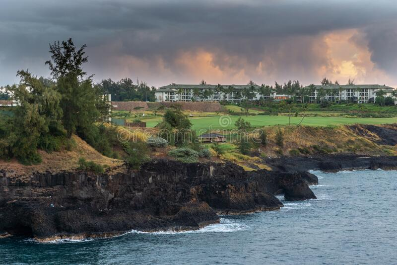 Marriott Kauai Lagoons - Kalanipuu and golf course in Nawiliwili, Kauai, Hawaii, USA. Nawiliwili, Kauai, Hawaii, USA. - January 11, 2012: Early morning light on royalty free stock photography