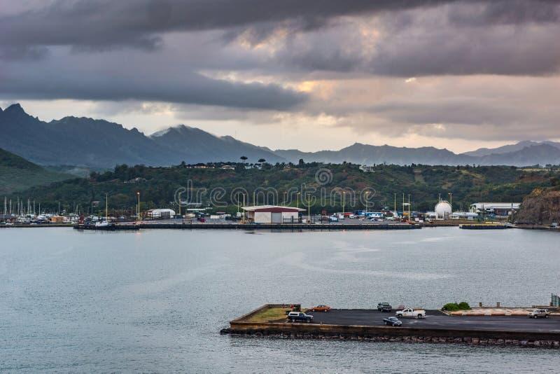 Nawiliwili port under cloudscape, Kauai, Hawaii, USA. Nawiliwili, Kauai, Hawaii, USA. - January 11, 2012: Early morning light on the small harbor with a stock photography