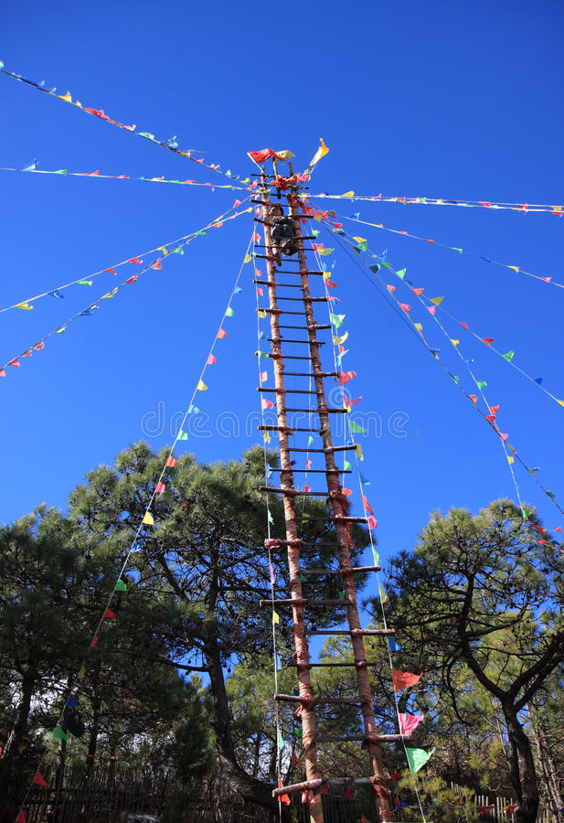 Naxi Ethnic Ladder Climbing royalty free stock images
