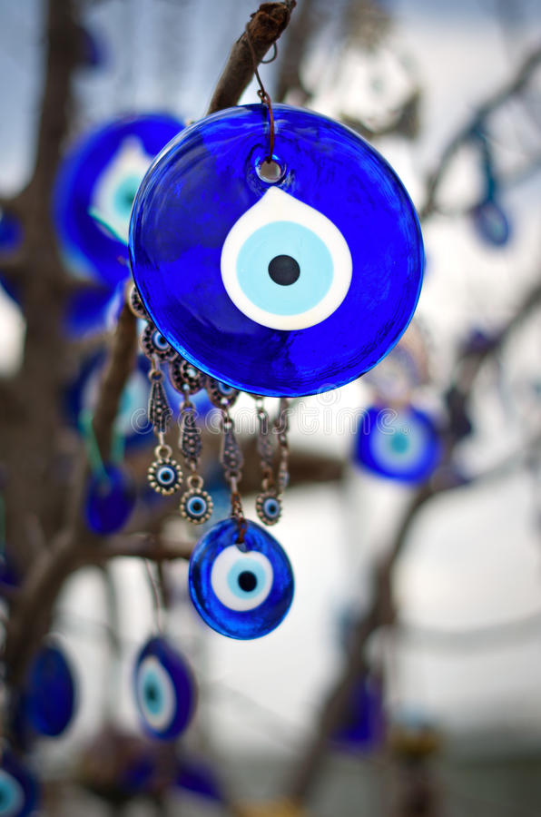 A nazar, charms to ward off the evil eye , in Cappadocia, Turke. A nazar, charms to ward off the evil eye , on the branches of a tree in Cappadocia, Turkey royalty free stock photography