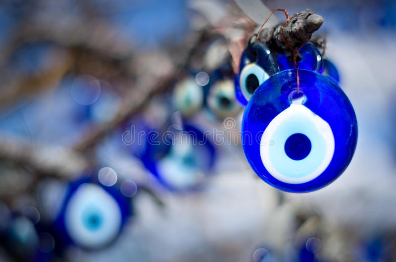 A nazar, charms to ward off the evil eye , in Cappadocia, Turkey. A nazar, charms to ward off the evil eye , on the branches of a tree in Cappadocia, Turkey royalty free stock photos