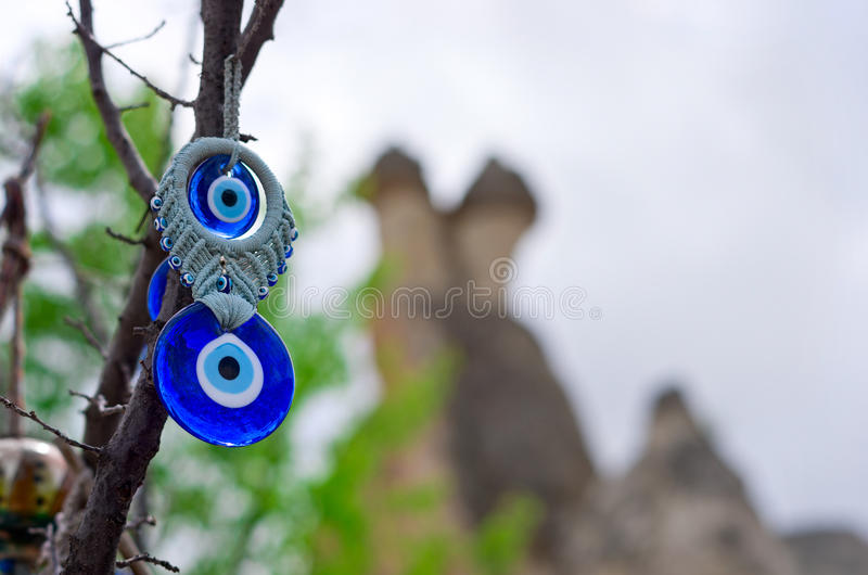A nazar, charms to ward off the evil eye , in Cappadocia, Turkey. A nazar, charms to ward off the evil eye , on the branches of a tree in Cappadocia, Turkey royalty free stock photo