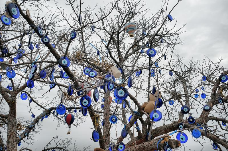 Nazar tree. Nazar, charms to ward off the evil eye , on the branches of a tree in Cappadocia, Turkey royalty free stock photography